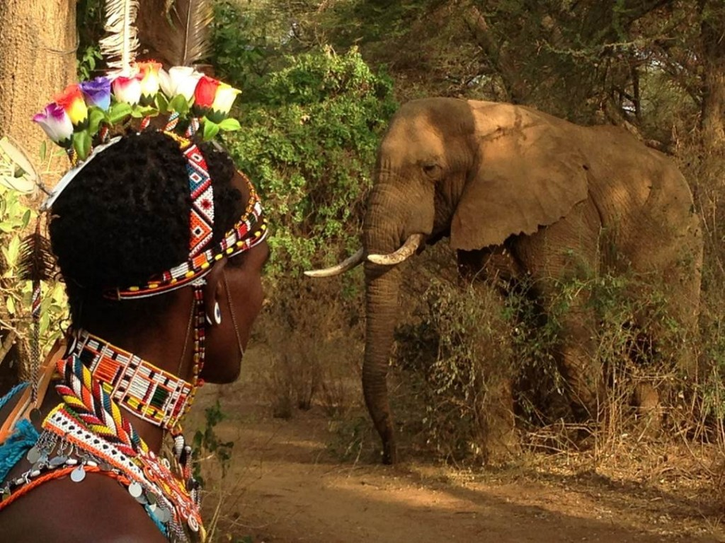 Samburu host at Elephant Watch Camp with elephant