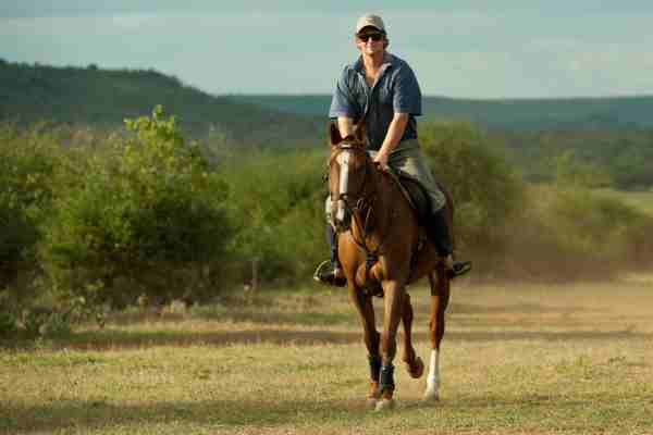 Simon Kenyon riding safari guide Sosian in Kenya