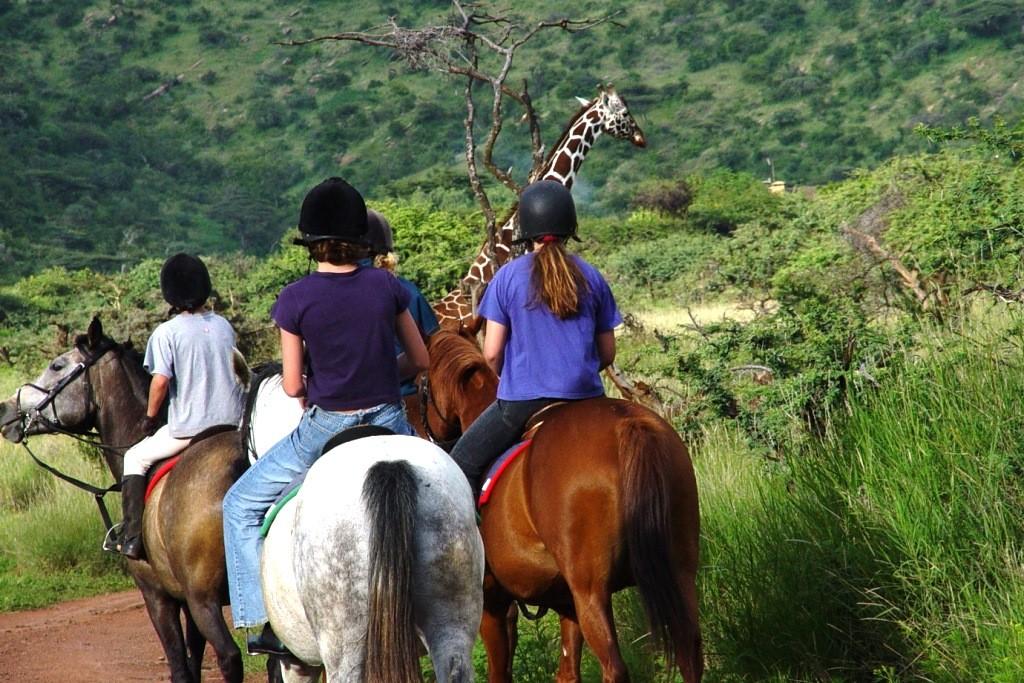 lewa-kenya-children-horseback-giraffe-1024-683-1024x683