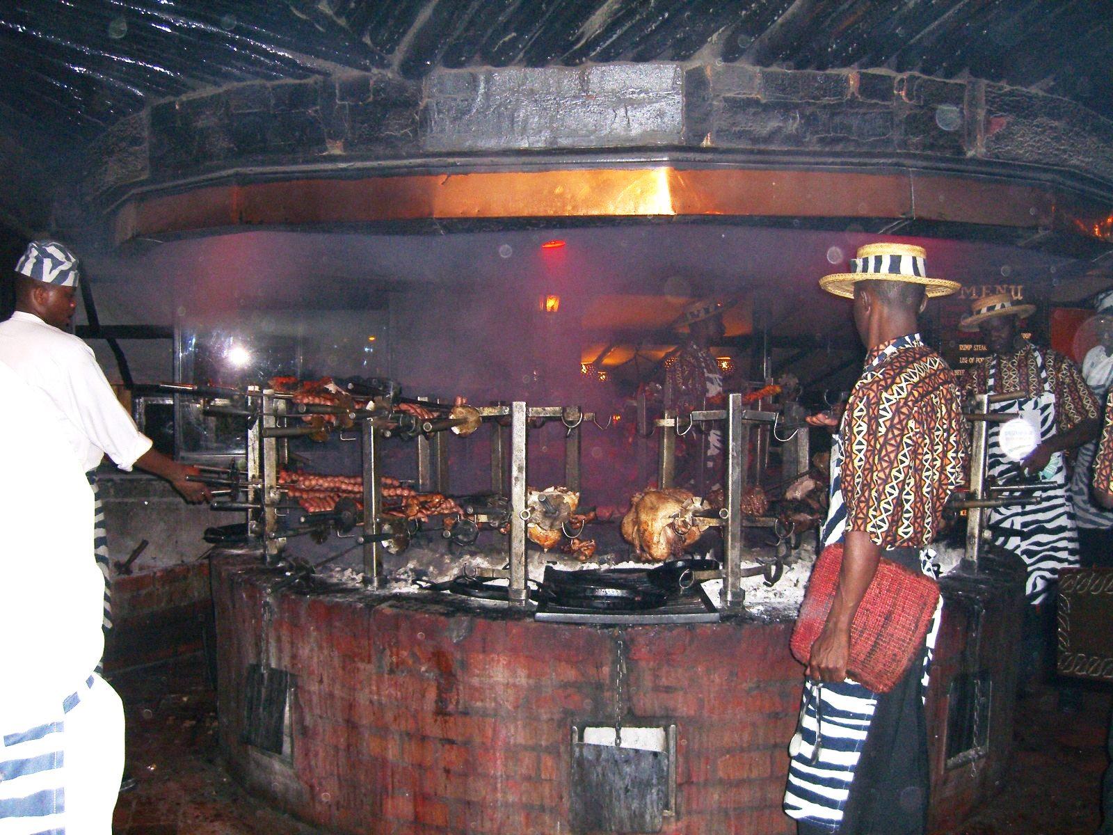 Meat_roasting_at_Carnivore_restaurant_in_Nairobi