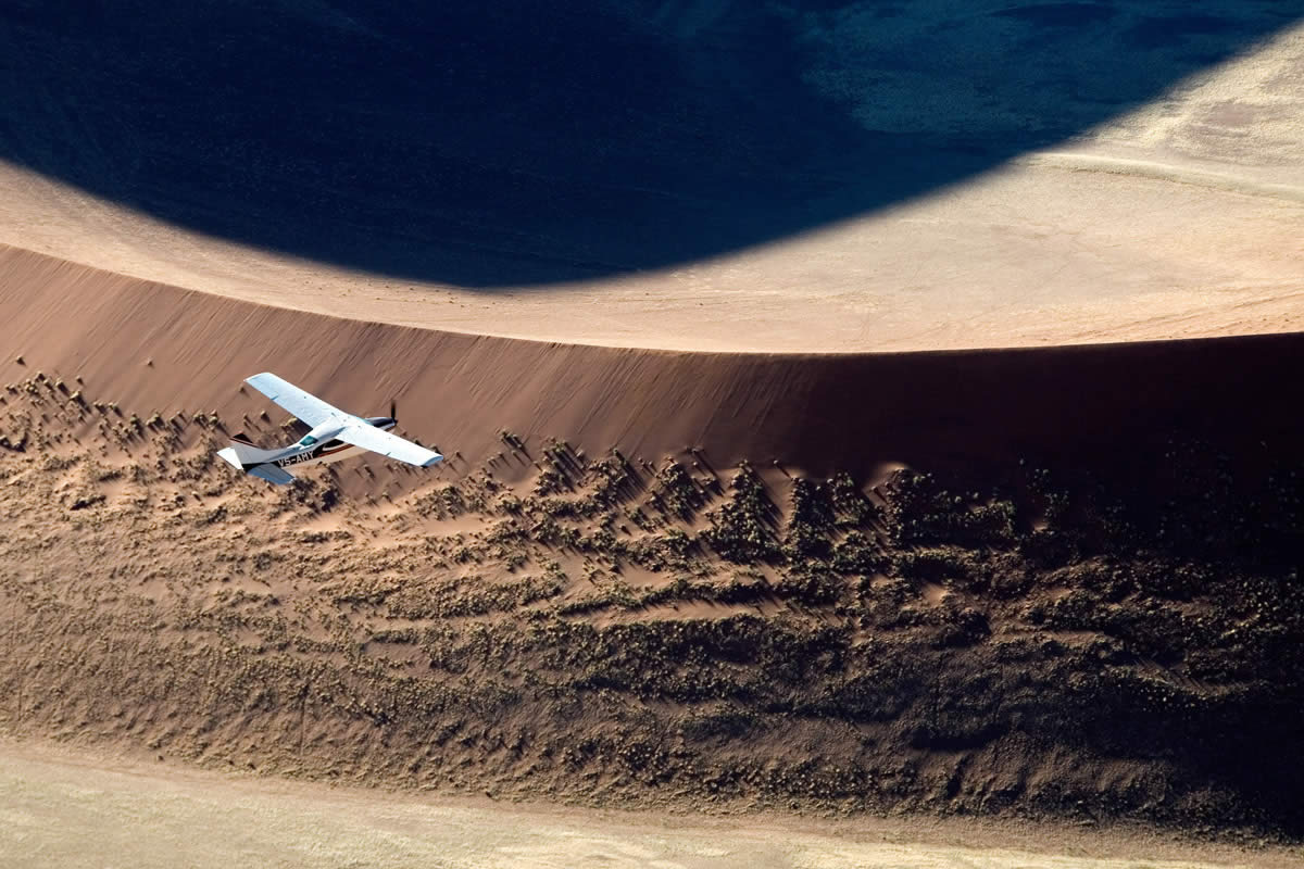 Skeleton Coast Safaris flying over Namibia dunes