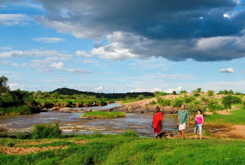Walking next to river evening Laikipia Wilderness Kenya