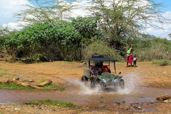 lattitude quad bike crossing a river in Kenya