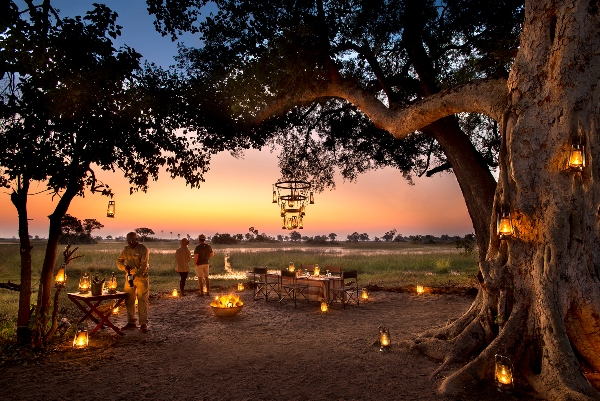 Botswana - And Beyond Botswana Expeditions sundowner drinks guests