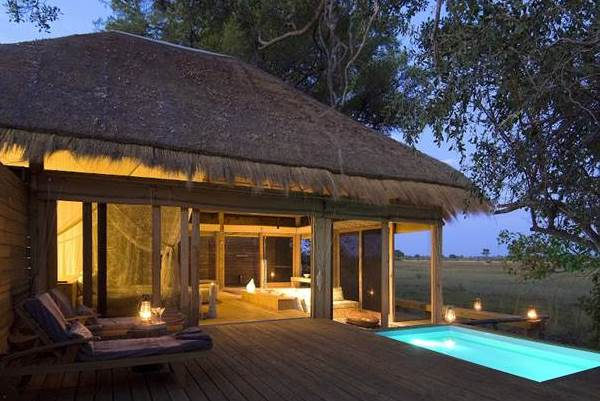 Vumbura Plains suite with plunge pool at night Okavango Delta Botswana wilderness safaris