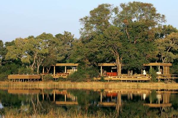 Vumbura Plains view of camp from river Okavango Delta Botswana wilderness safaris