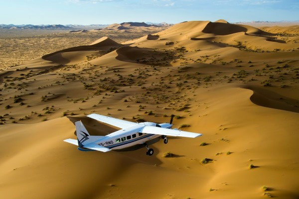 Kulala-Desert-Lodge-Sossusvlei-private-plane-dunes-sky-Namibia-@wildernesssafaris-600-400