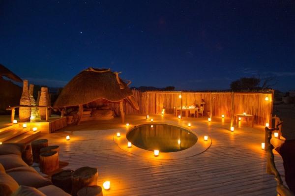 Little_Kulala-Namibia-dining-at-night-stars-5F8A6996L-DanielMyberg-@wildernesssafaris-600-400
