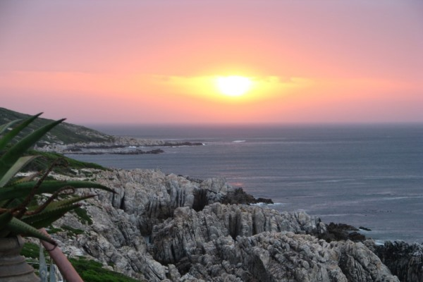 Sunset-deck-Cliff-Lodge-De-Kelders-WalkerBay-sunset-whales-southafrica
