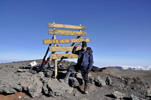 Francis at the top of Mount Kilimanjaro
