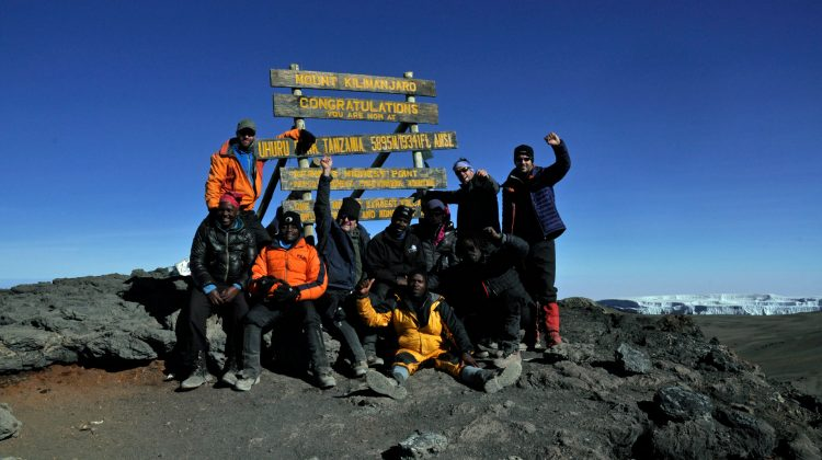 Francis successfully summiting Kilimanjaro with Summits Africa - Uhuru Peak