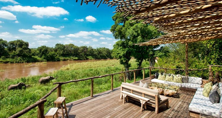 Narina Lion Sands lounge with a view of elephants by the river, Sabi Sands, South Africa