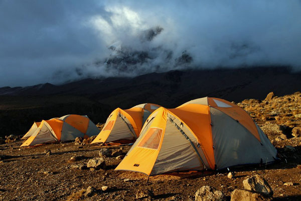 Kili-camp-tent-mist-sunset-SummitsAfrica