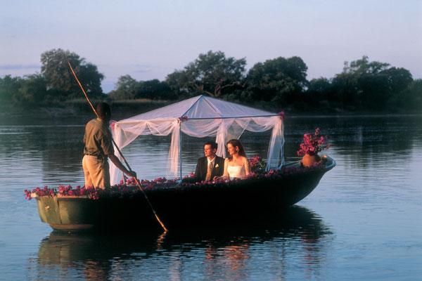 aardvark safaris facts - Robin Pope Safaris wedding couple on a boat Zambia