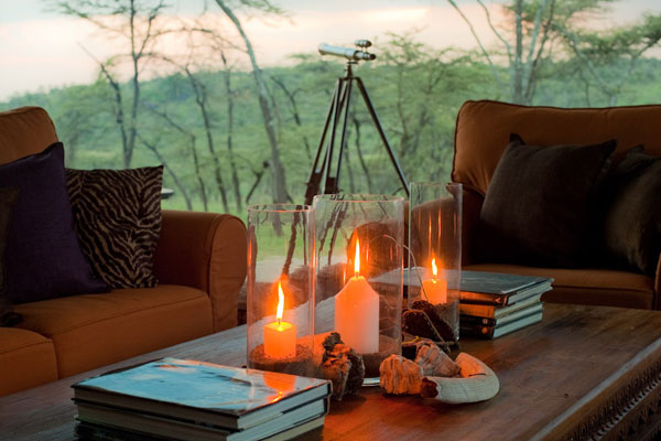 Candles and telescope in Communal lounge, Kicheche Valley Camp, Masai Mara, Kenya