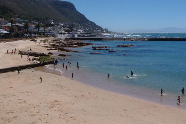 Kalk Bay beach family swimming © Explore + Escape