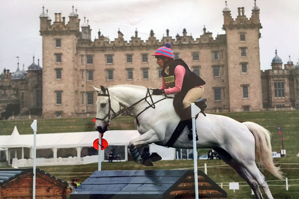 Alice competing on horse (grey thoroughbred) Floyd at Floors Castle, Scotland