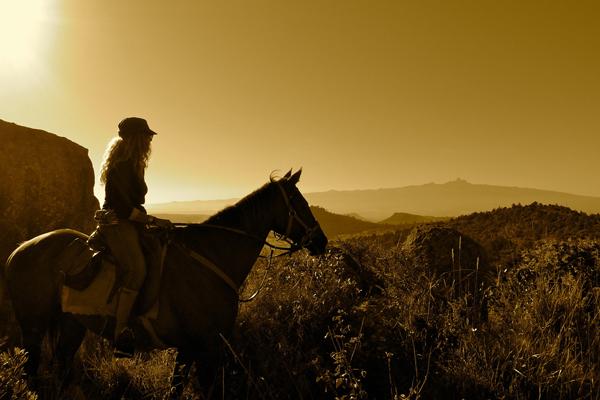 Nicky Dyer riding guide on horseback at Borana Lodge Kenya