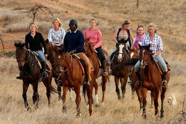 Guide with ladies riding group walking at Borana Riding, Kenya