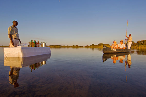 Couple canoe on the Okavango Delta Botswana Desert & Delta Safaris