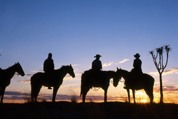 Fish River Canyon group of riders in silhouette Namibia Horse Safaris