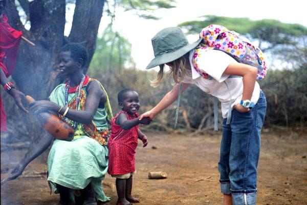 Children shaking hands Kenya by client Mark Walton