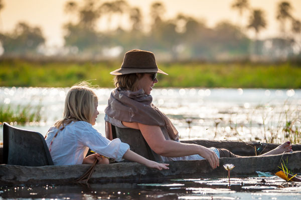 Family safari on mokoro Botswana Footsteps in Africa