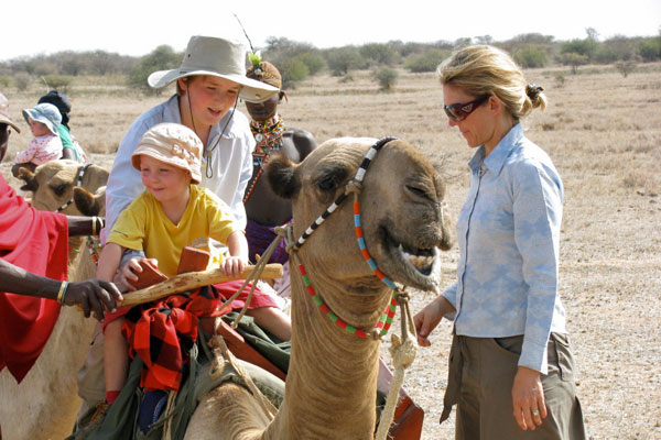 Children on camels at Karisia Walking Safaris, Kenya, with owner Kerry Glen