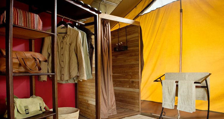 Packing for Safari; Tented Camp Bathroom suite Dunia Camp, Serengeti, Tanzania Asilia Africa
