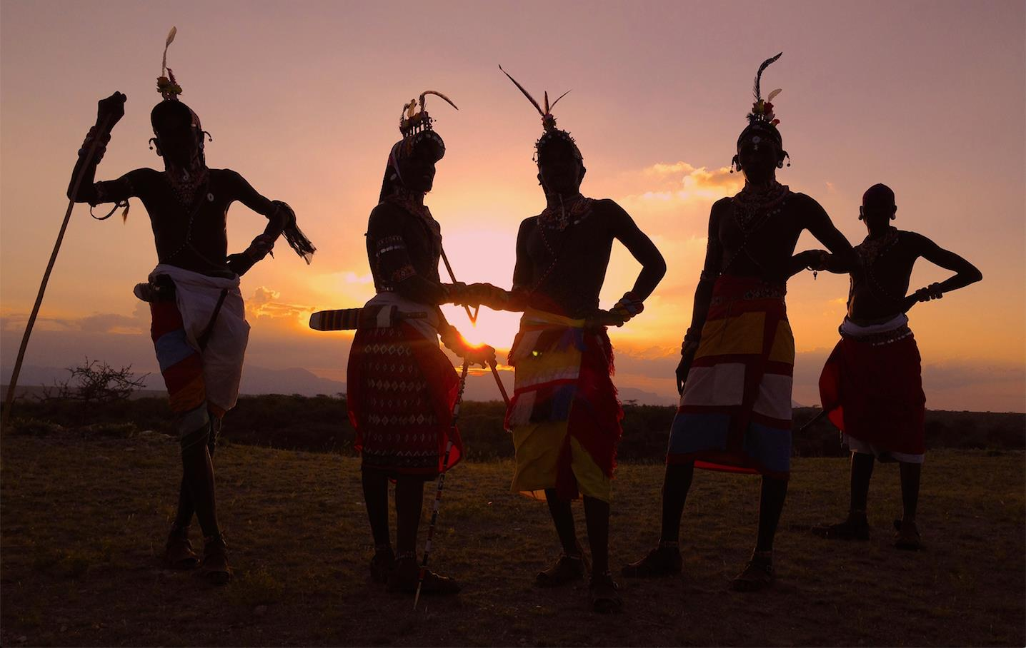 Sunset and 5 Samburu warriors © Saba Douglas-Hamilton