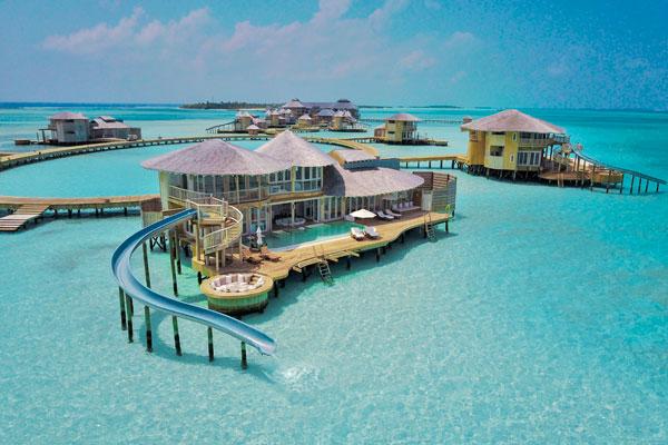 Waterslide beach bungalows at Soneva Jani, Maldives
