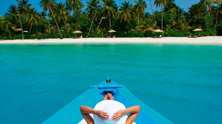 lady sunbathing on a dhoni, Maldives Constance Halaveli