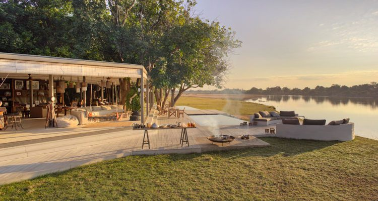 Time + Tide Chinzombo Camp view on the river luxury safari lodges
