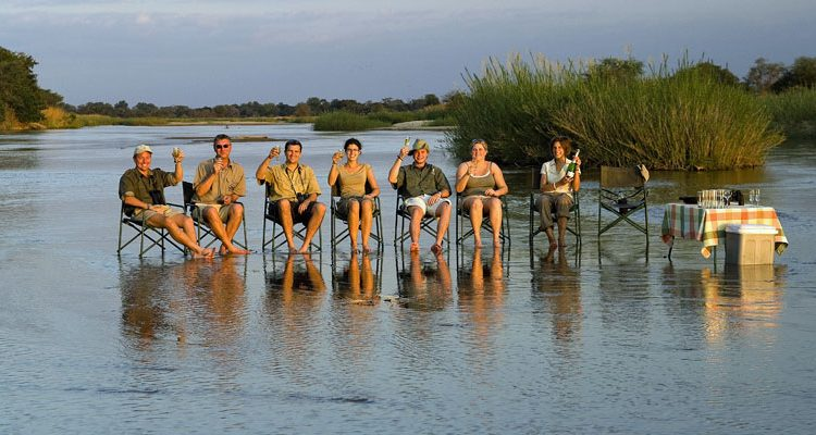 solo safari - walkers cooling off in a river in Zambia
