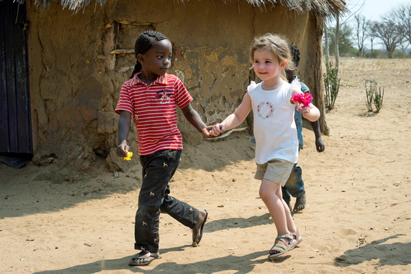 Children playing in a local Zambian village family safari experiences