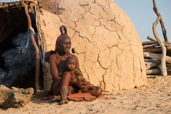 Himba mother and child new safari camp openings