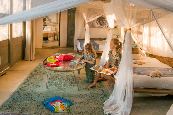 Kaingo Camp, two female children in bedroom suite family safari camps in Zambia