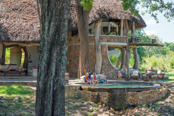 Family by the pool Luangwa River House family safari camps in Zambia