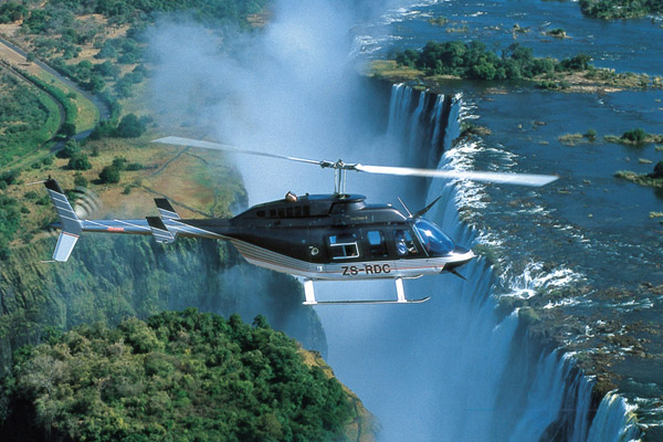 Take a helicopter flight over Victoria Falls family safari experiences
