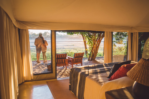 Walk-in tents, each with an open air bathroom, a viewing deck with comfortable chairs, and all with beautiful views across the Luangwa River, Tena Tena - luxury zambia safari