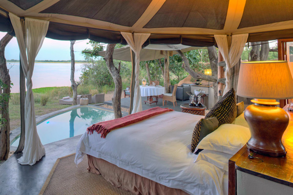 Tented chalets with en-suite facilities and private verandah overlooking the river, Time + Tide Chonge River Camp