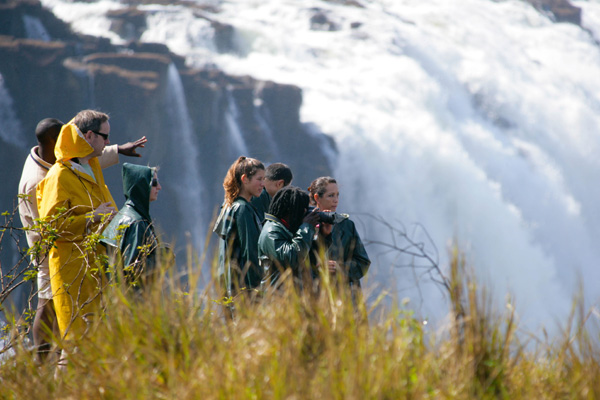Victoria Falls family visiting in waterproofs family safari experiences