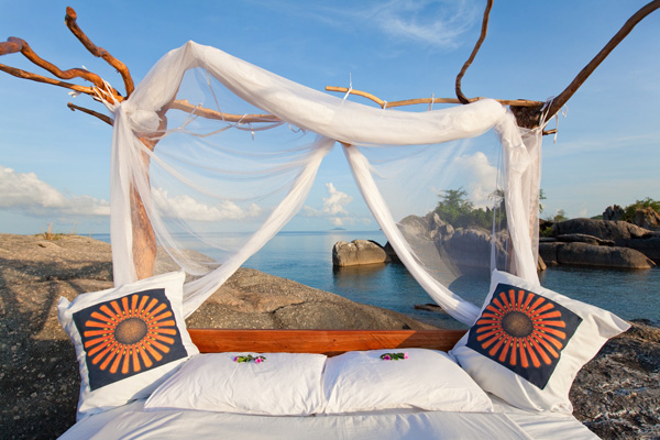 Enjoy the 'Lake of Stars' with a star bed at Nkwichi, Lake Malawi