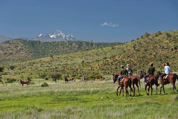 Riders with eland, Mount Kenya Rhino riding safari