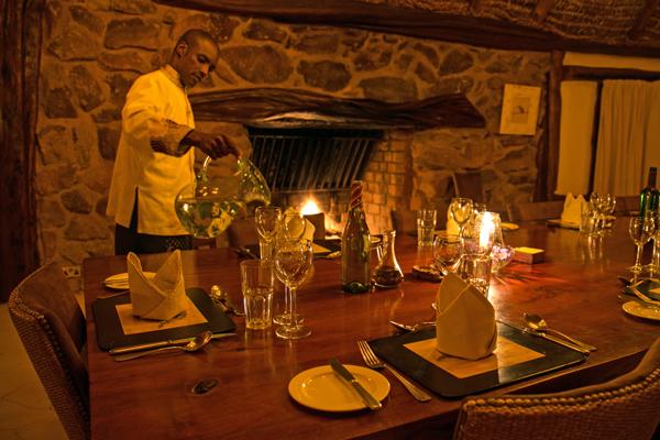 Fireside dining at Borana Lodge Rhino riding safari