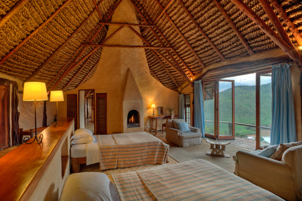 Cosy bedroom with fire and views over the Borana Conservancy