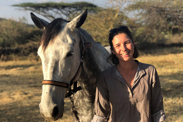 Riding safari guide Eloise Best with grey horse 'PunchesTown'