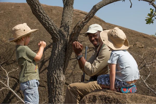 Nomad safari guide Remtullah Nassary teaching children
