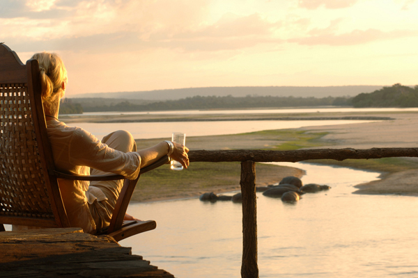 Sundowners with views over the river, Sand Rivers Selous, Selous, Nomad Tanzania