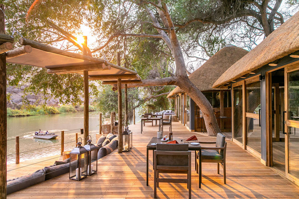 Glorious dining setting overlooking the Kunene River, Serra Cafema, Wilderness Safaris